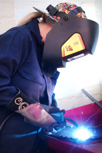 Female lawyer is welded to a new career...